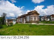 Купить «View of the Rosa Khutor mountain ski resort», фото № 30234256, снято 22 июня 2017 г. (c) Юлия Белоусова / Фотобанк Лори