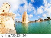 Купить «Downtown harbor old entrance towers of La Rochelle», фото № 30234364, снято 2 декабря 2017 г. (c) Сергей Новиков / Фотобанк Лори