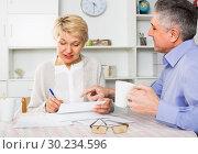 Купить «Mature man and woman are lead discussion», фото № 30234596, снято 19 марта 2019 г. (c) Яков Филимонов / Фотобанк Лори
