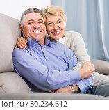 Купить «sweet mature married couple in house are warmly reconciled after quarrel», фото № 30234612, снято 16 октября 2019 г. (c) Яков Филимонов / Фотобанк Лори