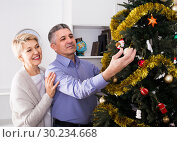 Купить «couple preparing to celebrate in his home Christmas and New Year», фото № 30234668, снято 19 марта 2019 г. (c) Яков Филимонов / Фотобанк Лори