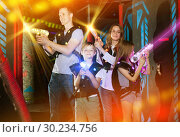 Купить «Kids and adults in beams on lasertag arena», фото № 30234756, снято 6 июня 2018 г. (c) Яков Филимонов / Фотобанк Лори