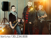Купить «expressive group of rock musicians posing with instruments», фото № 30234808, снято 26 октября 2018 г. (c) Яков Филимонов / Фотобанк Лори