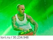 Купить «Выступление The Prodigy на фестивале Tuborg Greenfest», эксклюзивное фото № 30234948, снято 29 июня 2014 г. (c) Ольга Визави / Фотобанк Лори