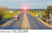 Купить «RUSSIA, SAMARA, June 1, 2016: Top view of the intense movement of the Samara-Togliatti track at sunset.», фото № 30235084, снято 1 июня 2016 г. (c) Акиньшин Владимир / Фотобанк Лори