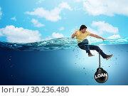 Купить «Young student in loan and debt concept», фото № 30236480, снято 19 марта 2019 г. (c) Elnur / Фотобанк Лори