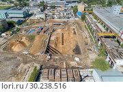 Купить «Construction site. Zero cycle construction work.», фото № 30238516, снято 5 июля 2018 г. (c) Андрей Радченко / Фотобанк Лори