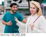 Купить «Husband and wife are emotional quarreling», фото № 30242264, снято 10 августа 2017 г. (c) Яков Филимонов / Фотобанк Лори