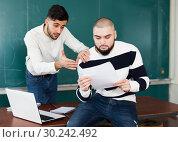 Купить «Student helping his worried friend», фото № 30242492, снято 17 декабря 2018 г. (c) Яков Филимонов / Фотобанк Лори