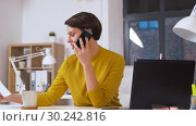 Купить «businesswoman calling on smartphone at office», видеоролик № 30242816, снято 28 февраля 2019 г. (c) Syda Productions / Фотобанк Лори