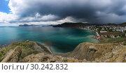 Купить «Beautiful panoramic view of dark thunderstorm clouds off the Black Sea coast near Feodosiya in the Crimea», фото № 30242832, снято 22 мая 2017 г. (c) Яна Королёва / Фотобанк Лори