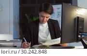 Купить «ui designer working on interface at night office», видеоролик № 30242848, снято 28 февраля 2019 г. (c) Syda Productions / Фотобанк Лори