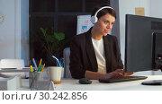 Купить «businesswoman in earphones with computer at office», видеоролик № 30242856, снято 28 февраля 2019 г. (c) Syda Productions / Фотобанк Лори
