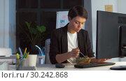 Купить «businesswoman eating and working at night office», видеоролик № 30242868, снято 28 февраля 2019 г. (c) Syda Productions / Фотобанк Лори