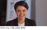 Купить «portrait of smiling businesswoman at night office», видеоролик № 30242892, снято 28 февраля 2019 г. (c) Syda Productions / Фотобанк Лори