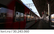 Купить «Modern high-speed train Lastochka. Little Ring of the Moscow Railways- MCC,or MK MZD, is a 54.4-kilometre-long orbital railway. Russia», видеоролик № 30243060, снято 3 марта 2019 г. (c) Владимир Журавлев / Фотобанк Лори