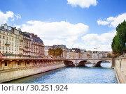 Купить «Bridge Pont Saint-Michel in Paris cite island», фото № 30251924, снято 6 августа 2016 г. (c) Сергей Новиков / Фотобанк Лори