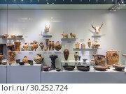 Купить «Showcase of artifacts in the Archaeological Museum in Heraklion, Crete, Greece», фото № 30252724, снято 5 июня 2017 г. (c) Наталья Волкова / Фотобанк Лори