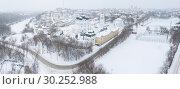 Купить «The city of Kirov and the high bank of the river Vyatka and the Alexander Grin Embankment and and Trifonov Monastery on a cloudy winter day», фото № 30252988, снято 11 июля 2020 г. (c) Mikhail Starodubov / Фотобанк Лори