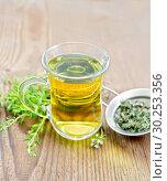Купить «Чай из тимьяна в кружке с ситечком на старой деревянной доске», фото № 30253356, снято 2 июля 2018 г. (c) Резеда Костылева / Фотобанк Лори