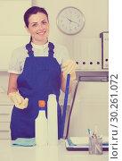 Купить «Cheerful female cleaning furniture in office», фото № 30261072, снято 2 июня 2017 г. (c) Яков Филимонов / Фотобанк Лори