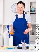Купить «Cheerful female cleaning furniture in office», фото № 30261080, снято 2 июня 2017 г. (c) Яков Филимонов / Фотобанк Лори