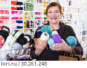 Купить «Woman holding shopping bags and accessories for knitting and embroidery», фото № 30261248, снято 10 мая 2017 г. (c) Яков Филимонов / Фотобанк Лори