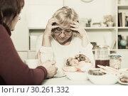 Купить «Upset mature lady having unpleasant talk with female», фото № 30261332, снято 22 ноября 2017 г. (c) Яков Филимонов / Фотобанк Лори