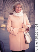 Купить «Cheerful adult woman in scarf», фото № 30261464, снято 27 ноября 2017 г. (c) Яков Филимонов / Фотобанк Лори