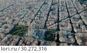 Купить «Aerial view of cityscape of Barcelona, Eixample district and Sagrada Familia», видеоролик № 30272316, снято 16 ноября 2018 г. (c) Яков Филимонов / Фотобанк Лори
