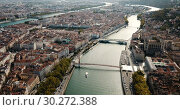 Купить «Panoramic view from drone of cityscape of Lyon in autumn day, France», видеоролик № 30272388, снято 24 октября 2018 г. (c) Яков Филимонов / Фотобанк Лори