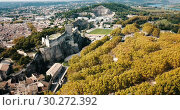 Купить «Aerial view of tower of fortified Chateau de Beaucaire in greenery on bank of Rhone river, France», видеоролик № 30272392, снято 29 октября 2018 г. (c) Яков Филимонов / Фотобанк Лори