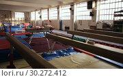 Купить «Image of interior of sport center with gymnastic equipment», видеоролик № 30272412, снято 12 февраля 2019 г. (c) Яков Филимонов / Фотобанк Лори