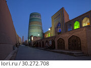 Купить «Evening view of the old town of Itchan-Kala. Illuminated minaret of Kalta Minor and Mohammed Amin-Khan madrasah», фото № 30272708, снято 20 октября 2016 г. (c) Юлия Бабкина / Фотобанк Лори