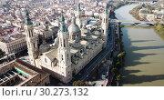 Купить «Aerial view of Zaragoza with Cathedral-Basilica of Our Lady of Pillar on bank of Ebro river, Spain», видеоролик № 30273132, снято 10 июня 2018 г. (c) Яков Филимонов / Фотобанк Лори