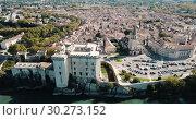 Купить «Aerial view of medieval fortified Chateau de Tarascon and Rhone river at sunny day», видеоролик № 30273152, снято 13 октября 2018 г. (c) Яков Филимонов / Фотобанк Лори