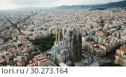 Купить «erial view of Sagrada Familia – impressive cathedral designed by Gaudi, Barcelona», видеоролик № 30273164, снято 19 ноября 2018 г. (c) Яков Филимонов / Фотобанк Лори