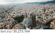 erial view of Sagrada Familia – impressive cathedral designed by Gaudi, Barcelona (2018 год). Редакционное видео, видеограф Яков Филимонов / Фотобанк Лори