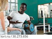 Купить «Man and woman talking at gym», фото № 30273656, снято 25 февраля 2019 г. (c) Яков Филимонов / Фотобанк Лори