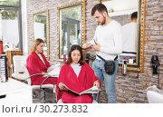Купить «Adult guy hairdresser working with woman hair in salon», фото № 30273832, снято 25 апреля 2018 г. (c) Яков Филимонов / Фотобанк Лори