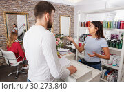 Купить «Man client talking with girl assistant about services at salon», фото № 30273840, снято 25 апреля 2018 г. (c) Яков Филимонов / Фотобанк Лори