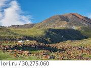 Купить «Mongolian landscape with mountain steppe under running cumulus clouds on blue sky, yurts and goats herd», фото № 30275060, снято 8 июля 2017 г. (c) Serg Zastavkin / Фотобанк Лори