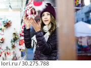 Купить «Portrait of female customer near counter with Christmas gifts», фото № 30275788, снято 22 декабря 2016 г. (c) Яков Филимонов / Фотобанк Лори