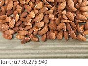 Купить «Heap of roasted almonds», фото № 30275940, снято 16 июля 2019 г. (c) Яков Филимонов / Фотобанк Лори