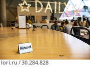 Купить «Reserved sign at a wooden table.», фото № 30284828, снято 5 марта 2019 г. (c) age Fotostock / Фотобанк Лори