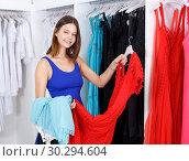 Купить «Woman shopping in clothing boutique», фото № 30294604, снято 17 сентября 2018 г. (c) Яков Филимонов / Фотобанк Лори