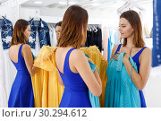 Купить «Girl trying new dress in front of mirror», фото № 30294612, снято 17 сентября 2018 г. (c) Яков Филимонов / Фотобанк Лори