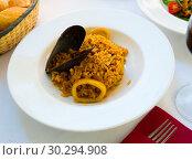 Купить «Tasty seafood dish – Paella a la marinera», фото № 30294908, снято 26 марта 2019 г. (c) Яков Филимонов / Фотобанк Лори