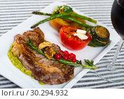 Купить «Photography of plate with baked veal with vegetables», фото № 30294932, снято 27 июня 2018 г. (c) Яков Филимонов / Фотобанк Лори