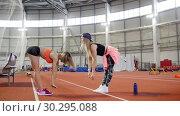 Купить «Two young athletic women warming up», видеоролик № 30295088, снято 21 марта 2019 г. (c) Константин Шишкин / Фотобанк Лори